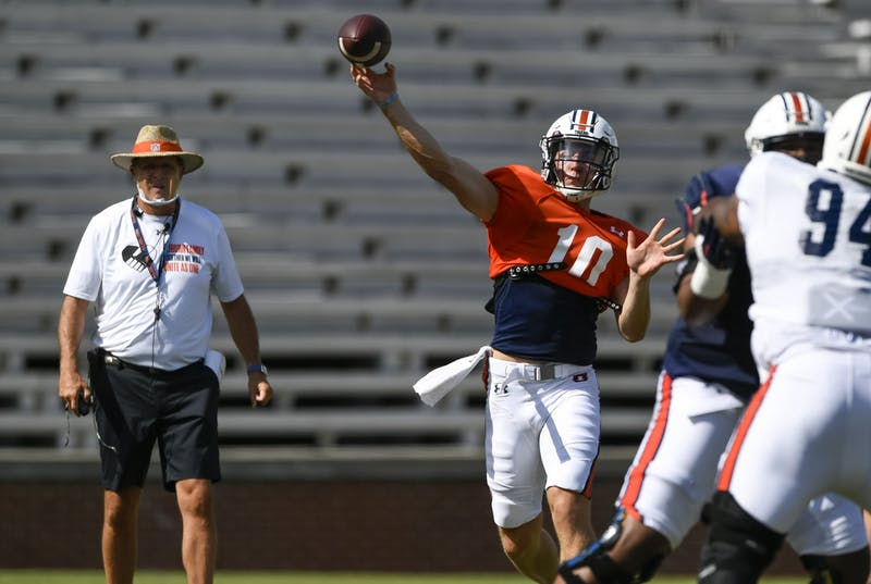 Bo Nix (10) with coach Gus Malzahn watching.