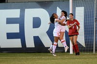 Marissa Arias (19) and Mallory Mooney (8) celebrate after Mooney's game-winning goal against Georgia in double overtime. Photo via: Eric Glemser | AU Athletics.