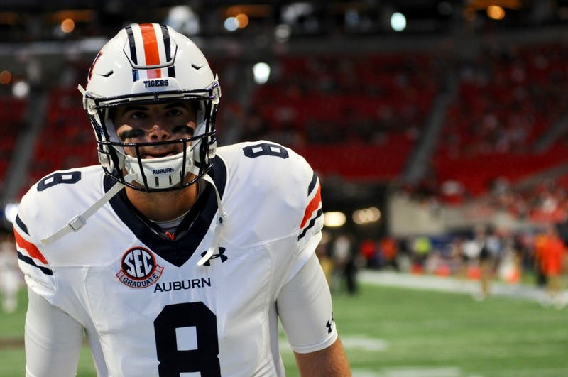 Jarrett Stidham (8) warms up before  Auburn Football vs. Washington on Saturday, Sept. 1, 2018 in Atlanta, Ga.
