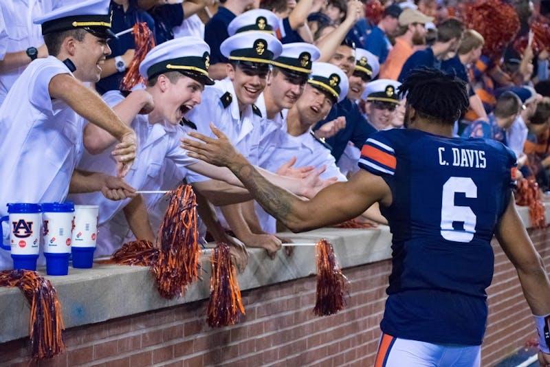 Carlton Davis (6)high-fives fans after Auburn vs Mississippi State on Saturday, Sept. 30 in Auburn, Ala.