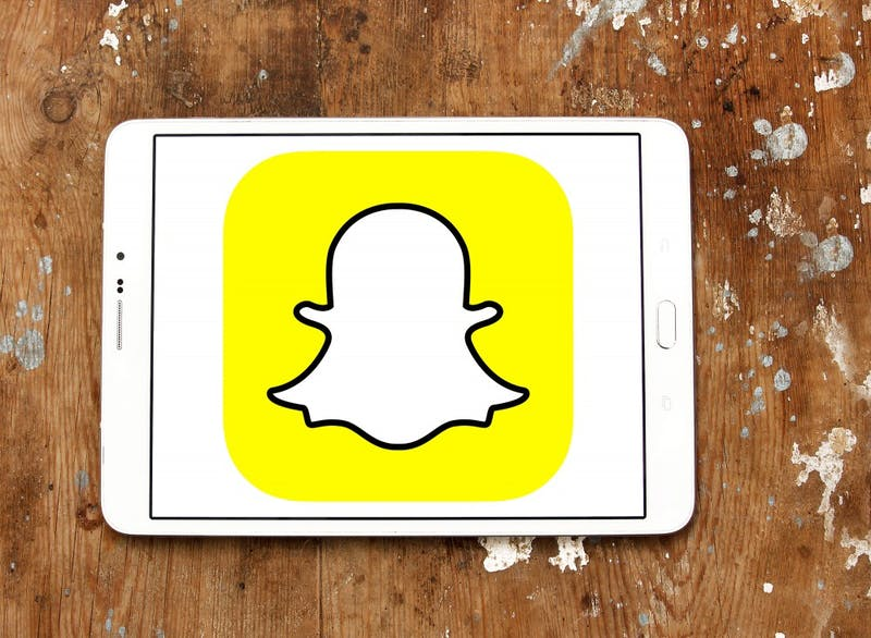 "Snap shares slid 6.4 percent on Tuesday, Oct. 9, 2018, to close at a new low of $7 after an analyst said the company behind the Snapchat video-messaging app was ""quickly running out of money"" and may need to raise new funding next year. (Mohamed Ahmed Soliman/Dreamstime/TNS)"