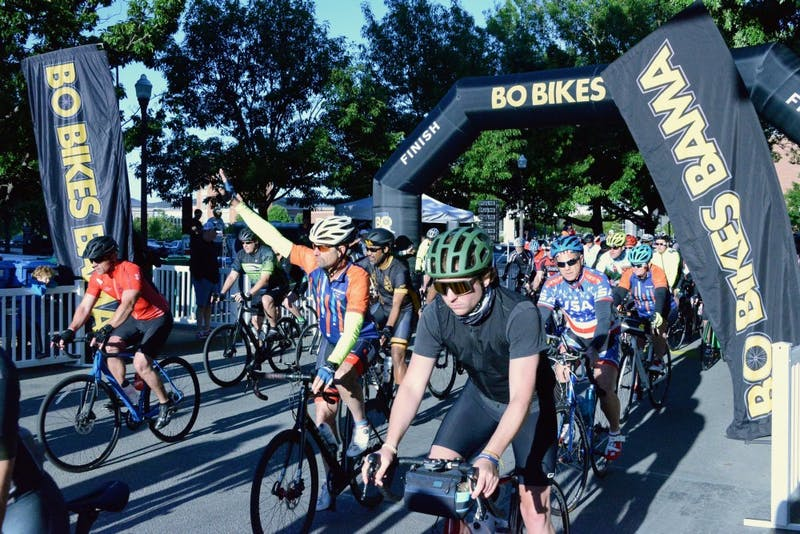 Bikers pass the starting line for Bo Bikes Bama on Saturday, April 27, 2019 in Auburn, Ala