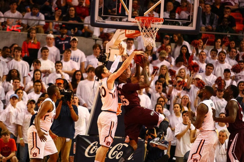 Alex Thompson, 20, blocks the shot of a Mississippi State player. (Kenny Moss | Photographer)