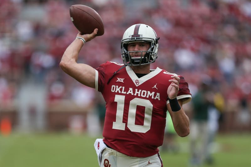 Redshirt sophomore quarterback Austin Kendall warms up before the game against Baylor Sept. 29. Courtesy of Caitlyn Epes/The OU Daily.