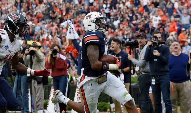 Senior Darrell Williams (49) records his first career interception and touchdown in Auburn's Senior Day win over Liberty on Nov. 17, 2018, in Auburn, Ala.