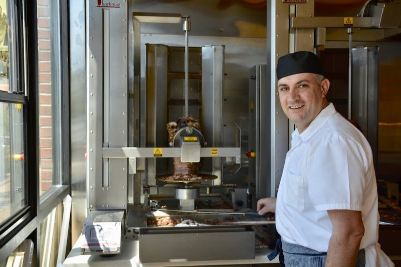 Sait Akagündüz owner of Royal Döner poses for a picture, on Wednesday, April 24, 2019, in Auburn, Ala.
