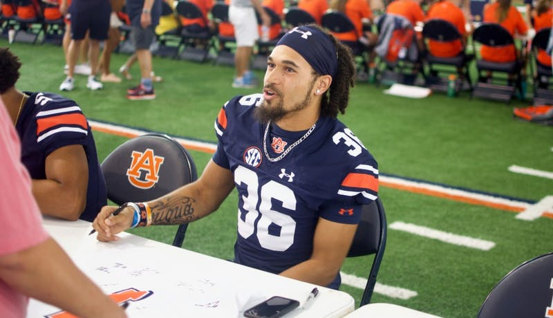 Kolbi Fuqua (36) signs autographsat Auburn Fan Day on Aug. 11, 2018, in Auburn, Ala.