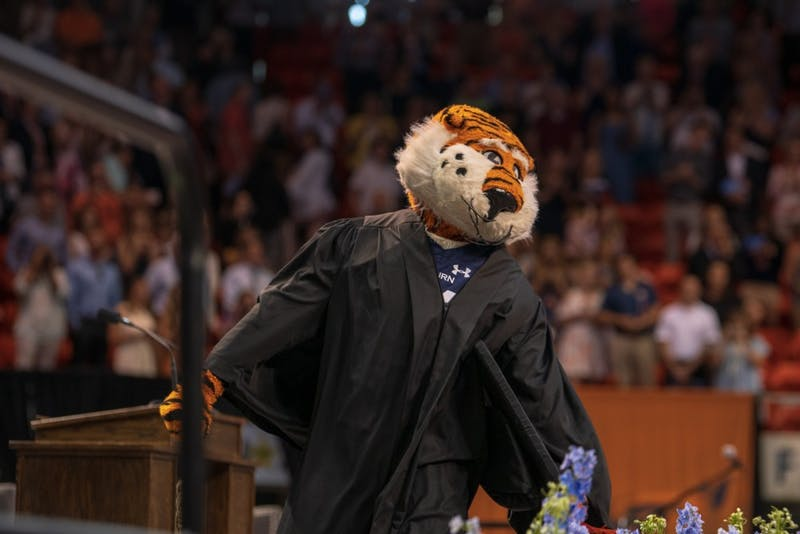 Aubie the Tiger dances on stage as he pumps up the crowd during spring commencement on Saturday, May 4, 2019, in Auburn, Ala.