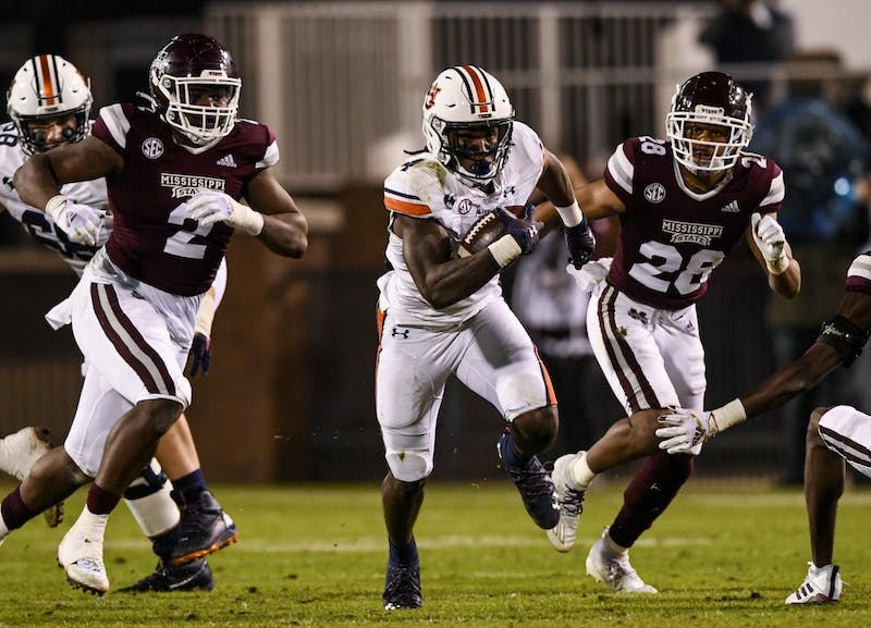 Tank Bigsby (4) chased by defenders during the game between Auburn and Mississippi State at Davis Wade Stadium on Dec 12, 2020; Starkville, Mississippi, USA. Photo via: Todd Van Emst/AU Athletics