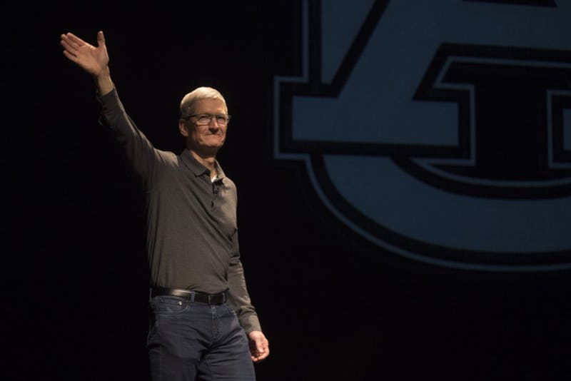 Tim Cook, Apple CEO and Auburn alumnus, walks onto the stage at the Telfair B. Peet Theatre, on Thursday, April 5, 2017 in Auburn, Ala.