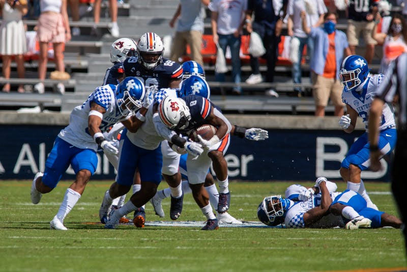 Shaun Shivers (8) pushes through defenders during Auburn Football vs. Kentucky on Saturday, Sept. 26, 2020, in Auburn, Ala.