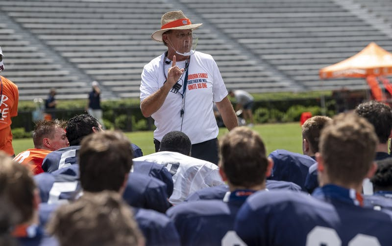 Coach Gus Malzahn talks to his team after practice Saturday.