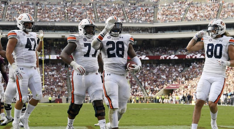 John Samuel Shenker (47), Marquel Harrell (77), JaTarvious Whitlow (28) and Sal Cannella (80) celebrate Whitlow's score.Auburn vs Texas A&M on Saturday, Sept. 21, 2019 in College Station, TX.Todd Van Emst/AU Athletics