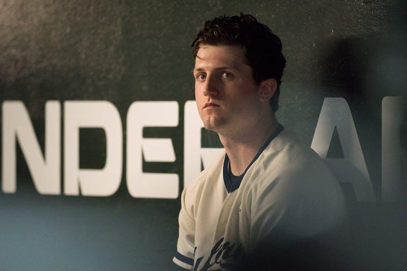 Casey Mize sits in the dugout during Auburn vs. Vanderbilt baseball on Friday, May 4, 2018, in Auburn, Ala.