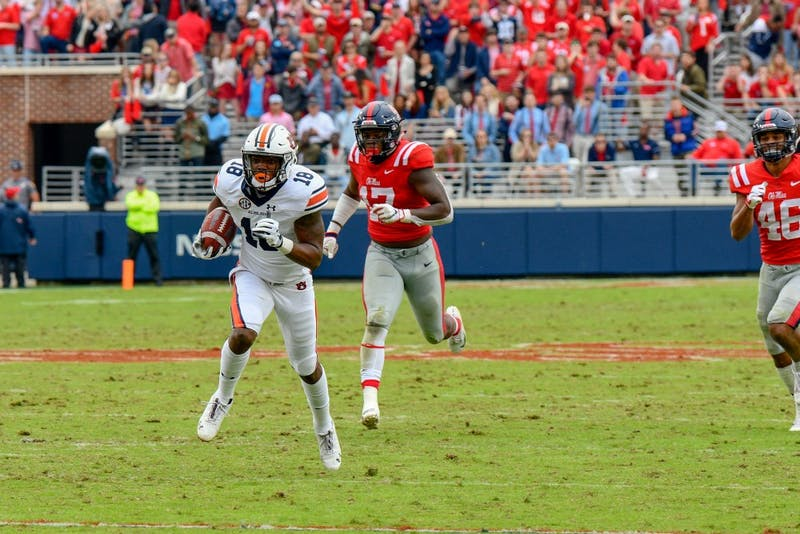 Seth Williams (18) runs the ball during Auburn Football vs. Ole Miss on Saturday, Oct. 20, 2018, in Oxford, Miss.