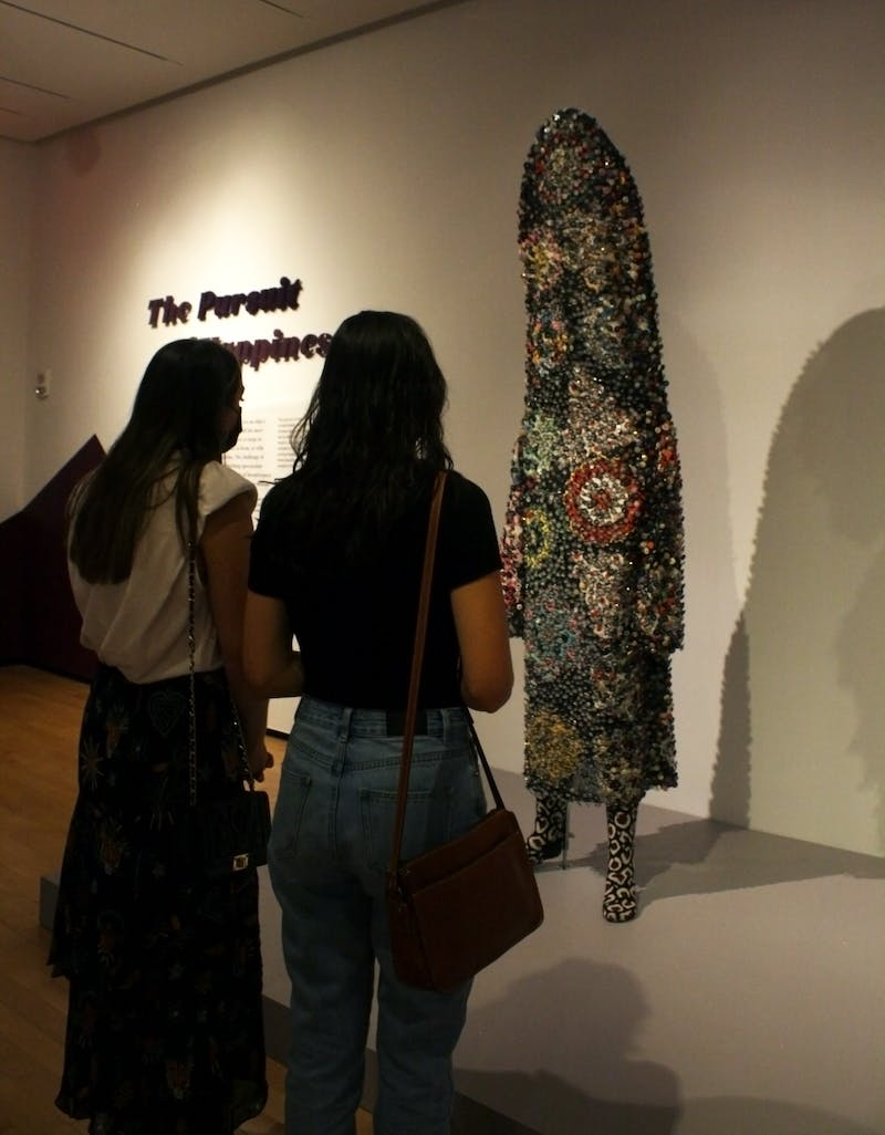 Auburn students Fendley Russel (left) and Katrina Messinger (right) observe Nick Cave's art display on Sep 9, 2021, at Jule Collins Smith Museum of Fine Art in Auburn, Ala.