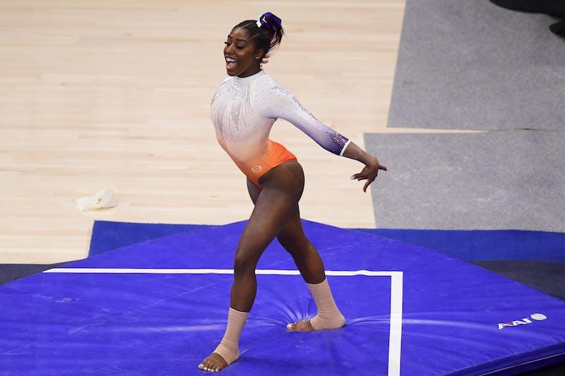 Mar 5, 2021; Auburn, AL, USA; Derrian Gobourne competes in floor during the gymnastics meet between Auburn and Arkansas  at Auburn Arena. Mandatory Credit: Shanna Lockwood/AU Athletics