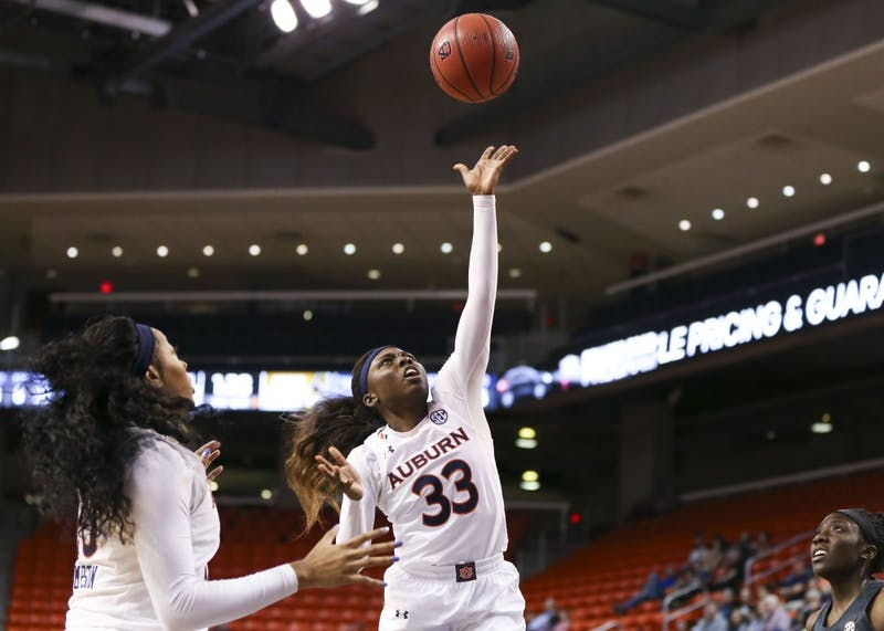 Janiah McKay (33) shoots the ball during Auburn women's basketball vs. Missouri on Sunday, Feb. 24, 2019, in Auburn, Ala.