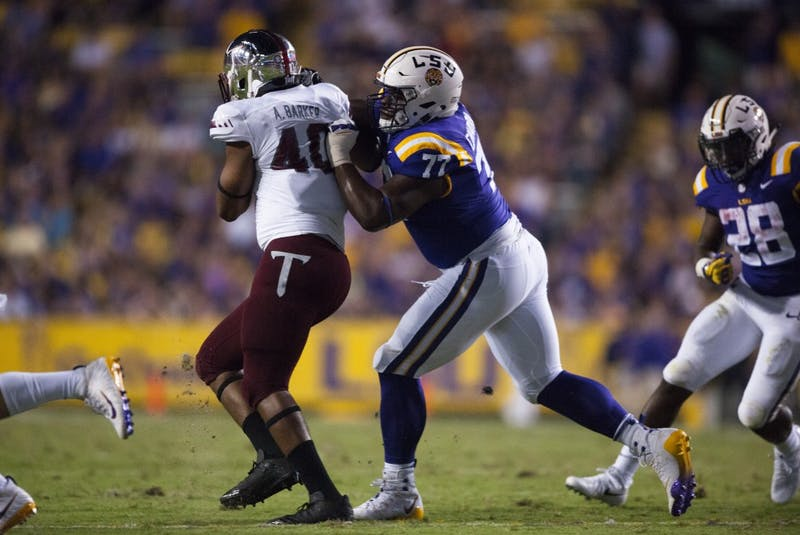 LSU freshman offensive lineman Saahdiq Charles (77) attemps to block during Tigers' 24-21 loss against Troy on Saturday, Sept. 30, 2017, in Tiger Stadium.  Photo courtesy of Alyssa Berry / The Daily Reveille.