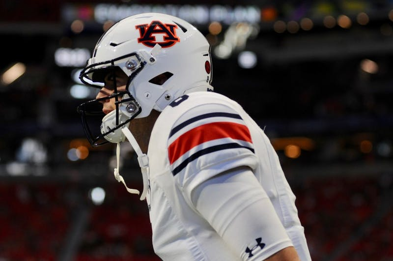 Jarrett Stidham (8) warms up before  Auburn Football vs. Washington on Saturday, Sept. 1, 2018 in Atlanta, Ga.
