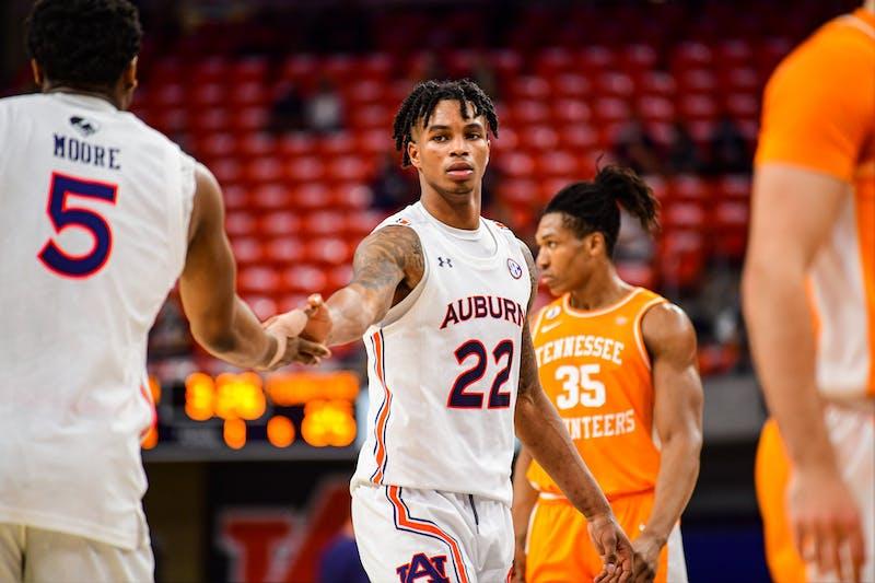 Auburn Tigers forward Chris Moore (5) and guard Allen Flanigan (22) react during the game between Auburn and Tennessee at Auburn Arena on Feb 27, 2021; Auburn, AL, USA. Photo via: Shanna Lockwood/AU Athletics