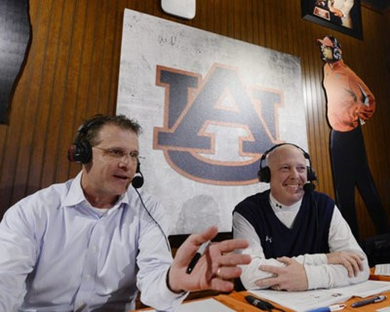 "Rod Bramblett talks with head football coach Gus Malzahn during a ""Tiger Talk"" radio show in 2013. (Photo contributed by Auburn Athletics)"