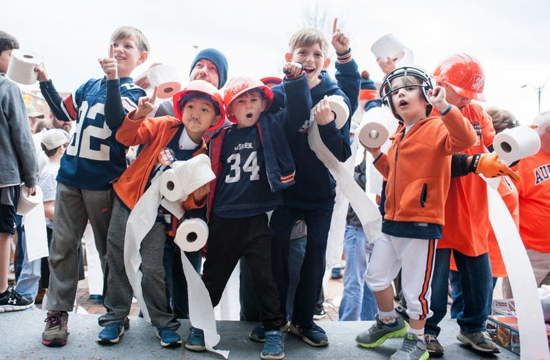 Young fans gather at Toomer's Corner for a rolling demonstration at the start of College Gameday. Auburn vs Alabama on Saturday, Nov. 25 in Auburn, Ala.