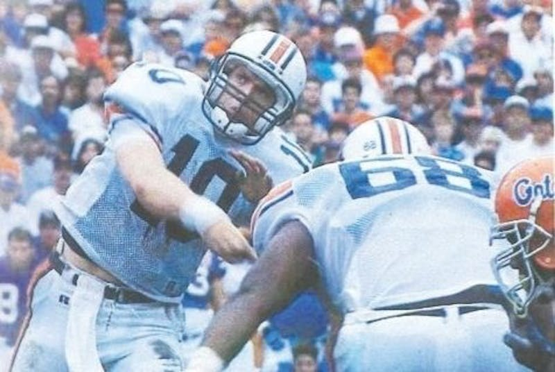 Pat Nix (10) throws a pass during Auburn at Florida. Photo via 1995 edition of The Glomerata, Auburn's annual yearbook.
