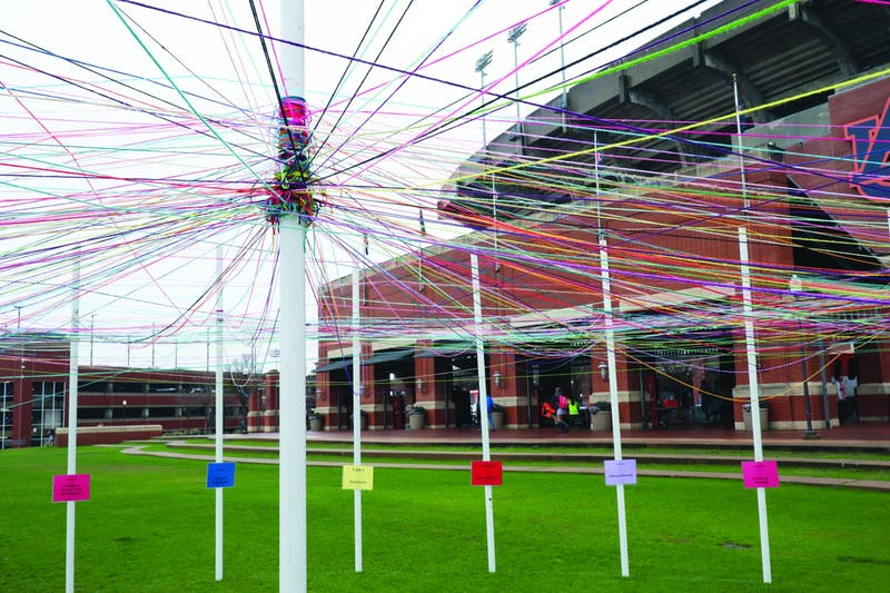 The Unity Project consisted of 32 poles on the Green Space that were labelled with identities for students to connect with yarn.