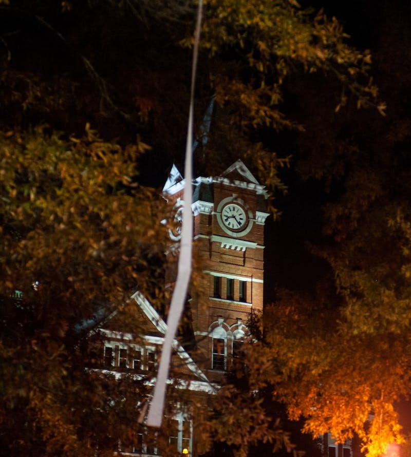 A single strand of toilet paper hangs from a tree in front of Samford Hall. Auburn vs Alabama on Saturday, Nov. 25 in Auburn, Ala.