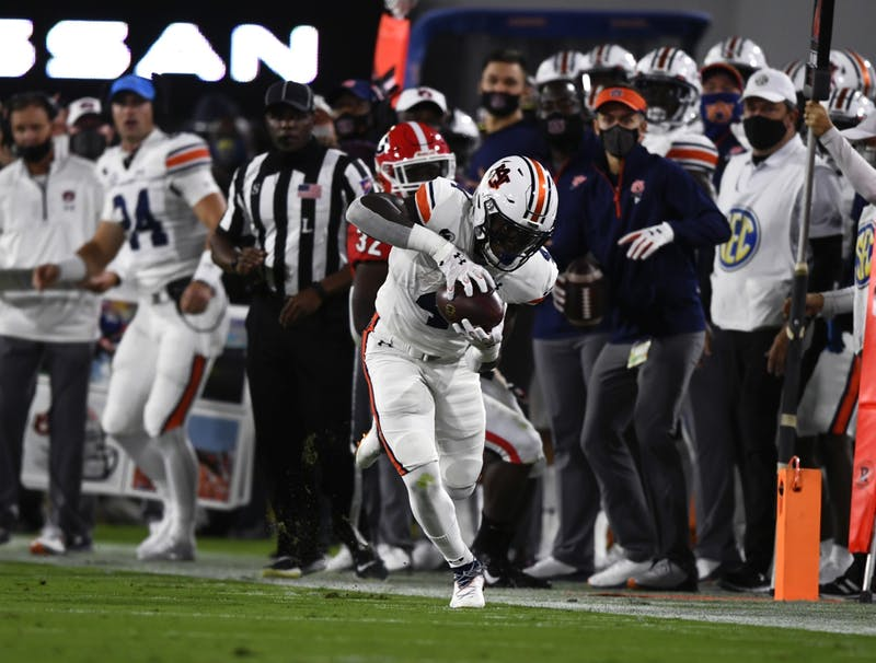 Oct 3, 2020; Athens, GA, USA; Tank Bigsby (4) runs the ball in the first quarter during the game between Auburn and Georgia at Samford Stadium. Todd Van Emst/AU Athletics