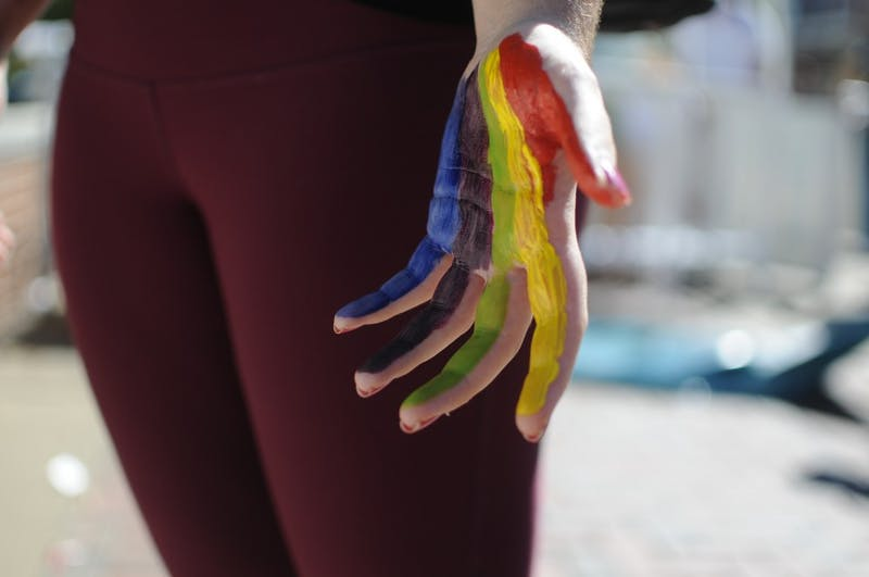 Nairika Hough, a sophomore in graphic design, paints her handto celebrate Pride Week withSpectrum on Wednesday, Oct. 5, 2016 at Haley Concourse.