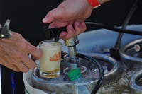 A host pours a guest a sample for Oktoberfest on Saturday, Oct. 6, 2018 in Auburn, Ala.