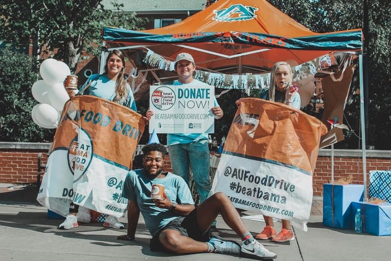 The University of Alabama's Beat Auburn, Beat Hunger Food Drive came out on top, but the two schools raised the most this year in the competition's 25-year history.