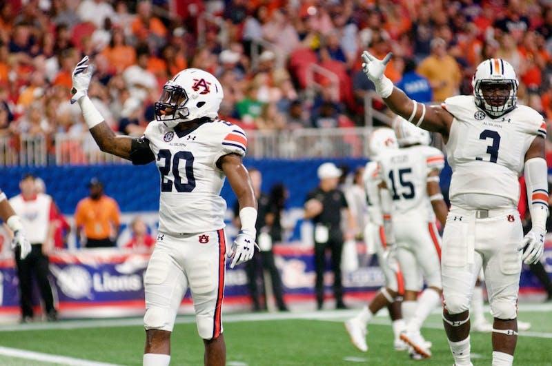 Jeremiah Dinson (20) and Marlon Davidson (3) celebrate during Auburn Football vs. Washington on Saturday, Sept. 1, 2018 in Atlanta, Ga.