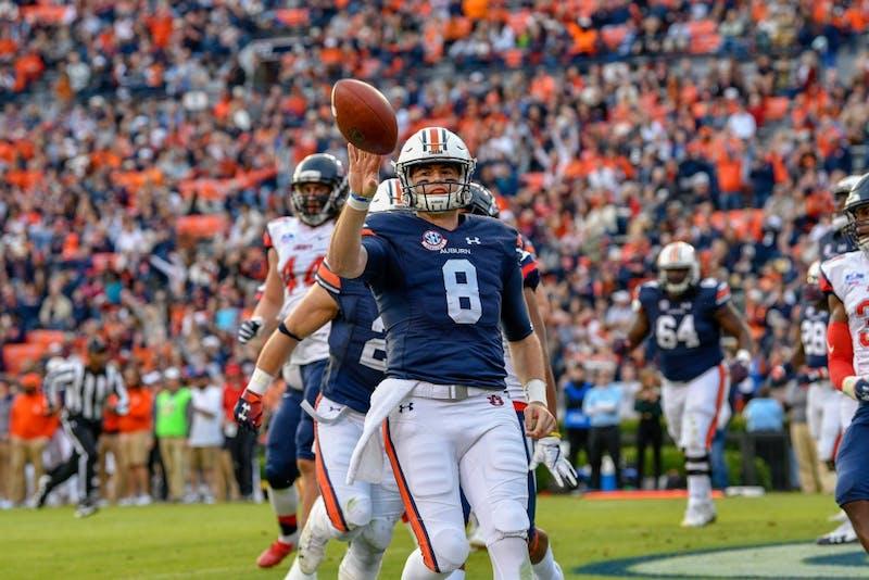 Jarrett Stidham (8) flips the ball during Auburn Football vs Liberty on Saturday,  Nov. 17, 2018, in Auburn, Ala.