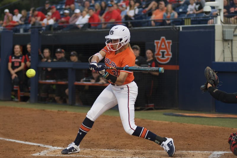Alyssa Rivera (21) hits the ball during Auburn softball vs. Georgia on March 29, 2019, in Auburn, Ala.
