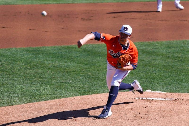 Feb 21, 2021; Auburn, AL, USA; Auburn Tigers pitcher Mason Barnett (18) pitches the ball during the game between Auburn and Presbyterian at Auburn Arena. Mandatory Credit: Jacob Taylor/AU Athletics