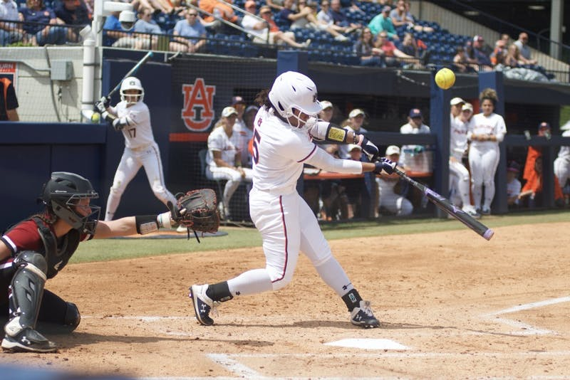 Bree Fornis (15) hits the ball during the Auburn softball vs. South Carolina game, Sunday, April 14, 2019, in Auburn, Ala.