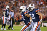 Bo Nix (10) runs to the sideline with JaTarvious Whitlow (28) during Auburn vs. Kent State, on Saturday, Sept. 14, 2019, in Auburn, Ala.
