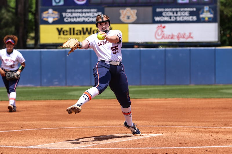 April 18, 2021; Auburn, AL, USA; Shelby Lowe (55) pitches the ball during the game between Auburn and Kentucky at Jane B. Moore Field . Mandatory Credit: Jacob Taylor/AU Athletics