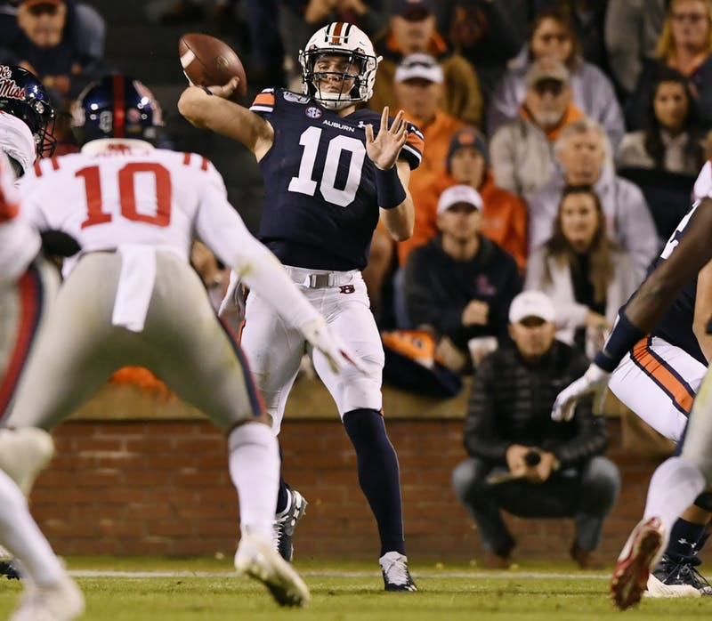 Bo Nix (10) throws to Anthony Schwartz (5) in the first half.Auburn vs Ole Miss football on Saturday, Nov 2, 2019 in Auburn, Ala.Todd Van Emst