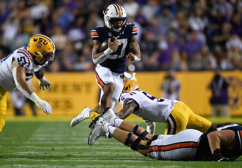 Oct 2, 2021; Baton Rouge, LA, USA; Jarquez Hunter (27) carries ball between Auburn and Louisiana State University at Tiger Stadium. Mandatory Credit: Todd Van Emst/AU Athletics