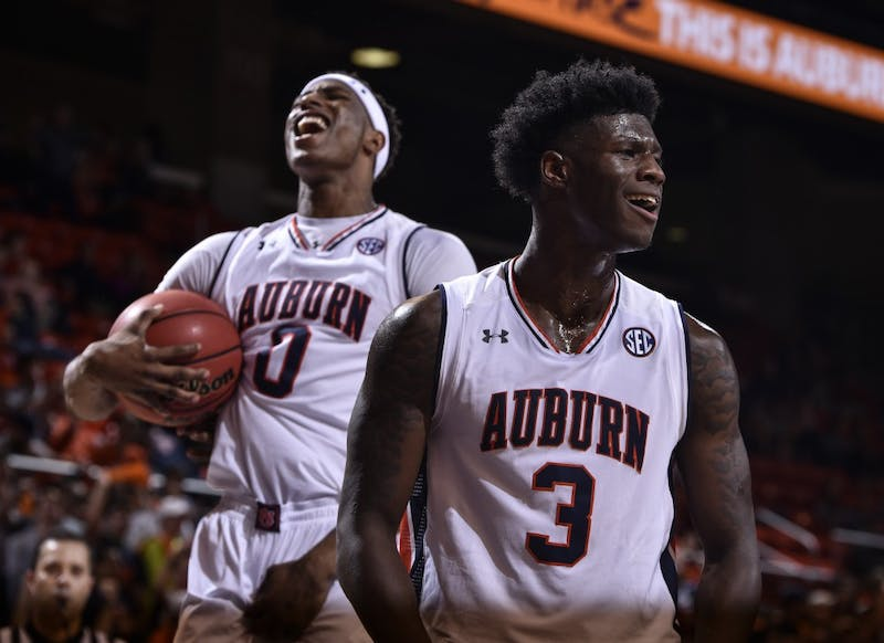 Danjel Purifoy (3) celebrates with Horace Spencer (0) in the background during the second half of a NCAA college basketball game, Monday, Nov. 14, 2016, in Auburn, Ala.