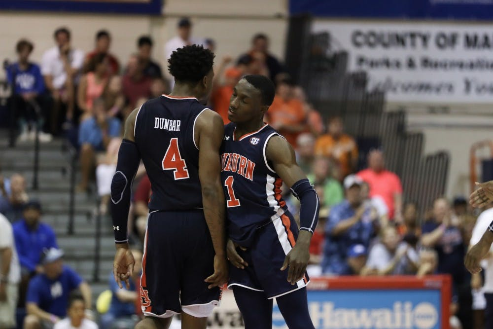 Jared Harper wills Auburn to overtime win over turnover-prone Xavier in Maui