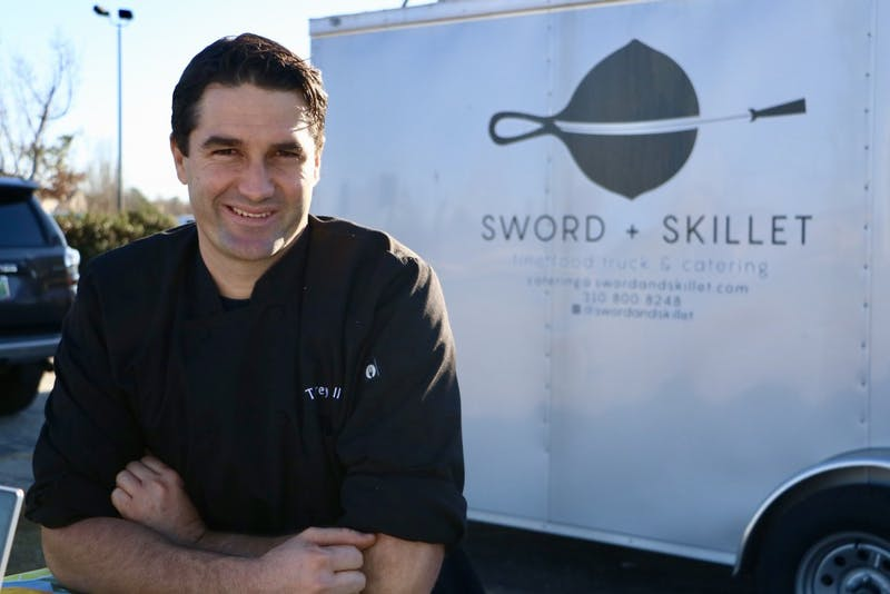Chef Torrey Hall, owner of the Sword and Skillet food truck, speaks on his business Feb. 13, 2019, in Auburn, Ala.