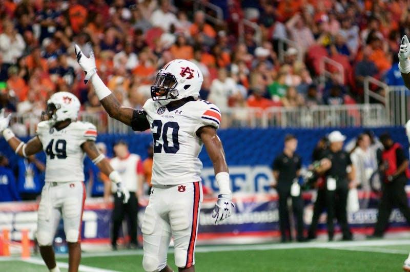 Jeremiah Dinson (20) and Darrell Williams (49) celebrate during Auburn Football vs. Washington on Saturday, Sept. 1, 2018 in Atlanta, Ga.