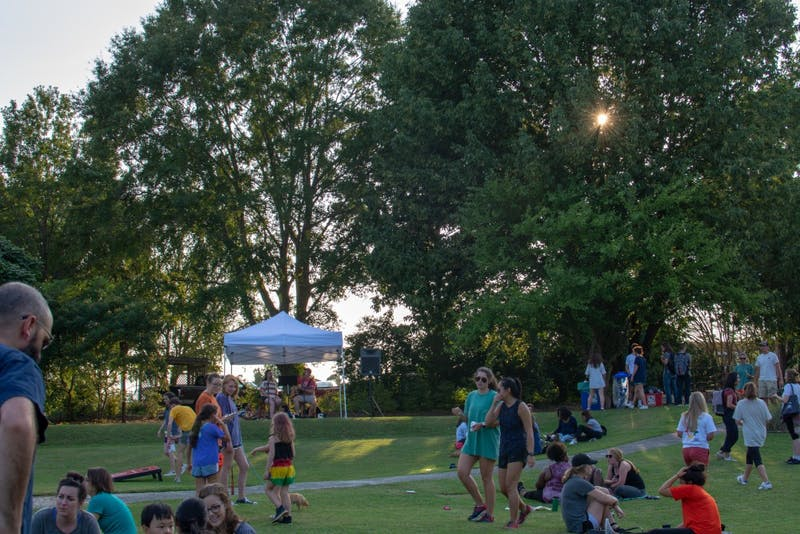 Members of the public enjoy the evening taking part in the Sustainability Picnic at Donald E. Davis Arboretum on Wednesday, Aug. 22, 2018, in Auburn, Ala.