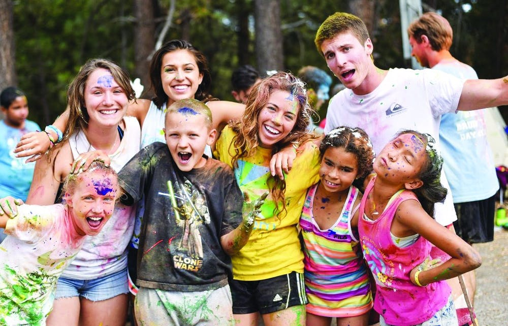 Students volunteer at camp for children of sick parents