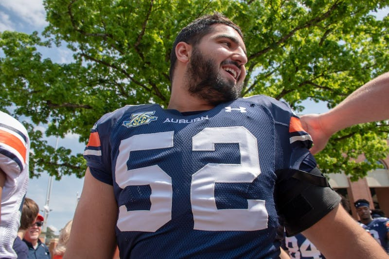 Nick Brahms (52) walks through Tiger walk prior to A-Day 2019, on Saturday, April 13, 2019, in Auburn, Ala.